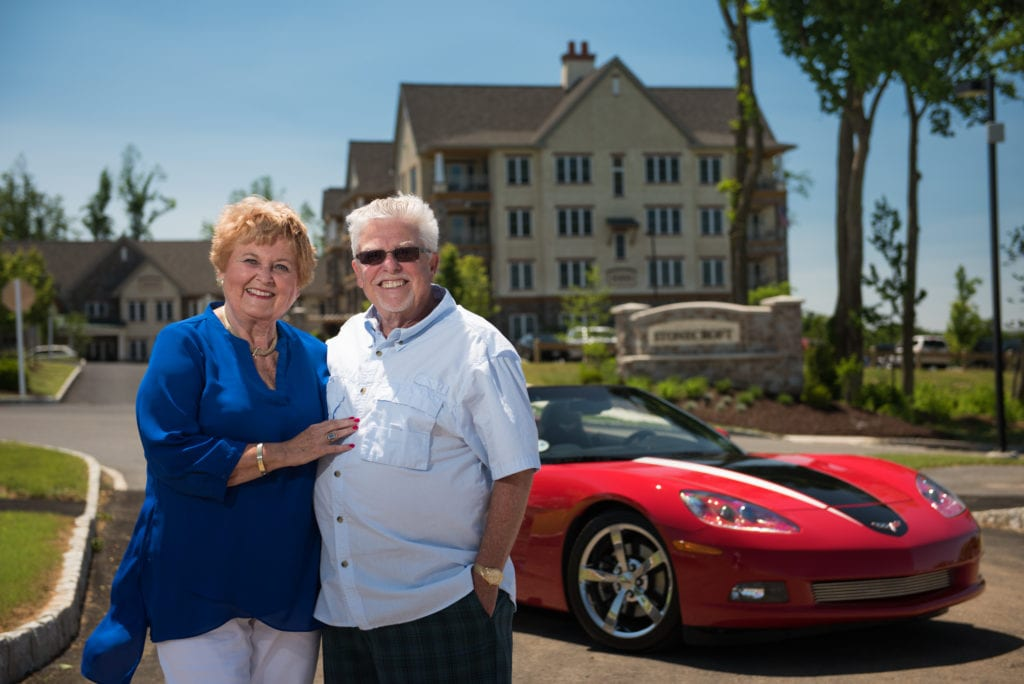 Retired couple and their corvette