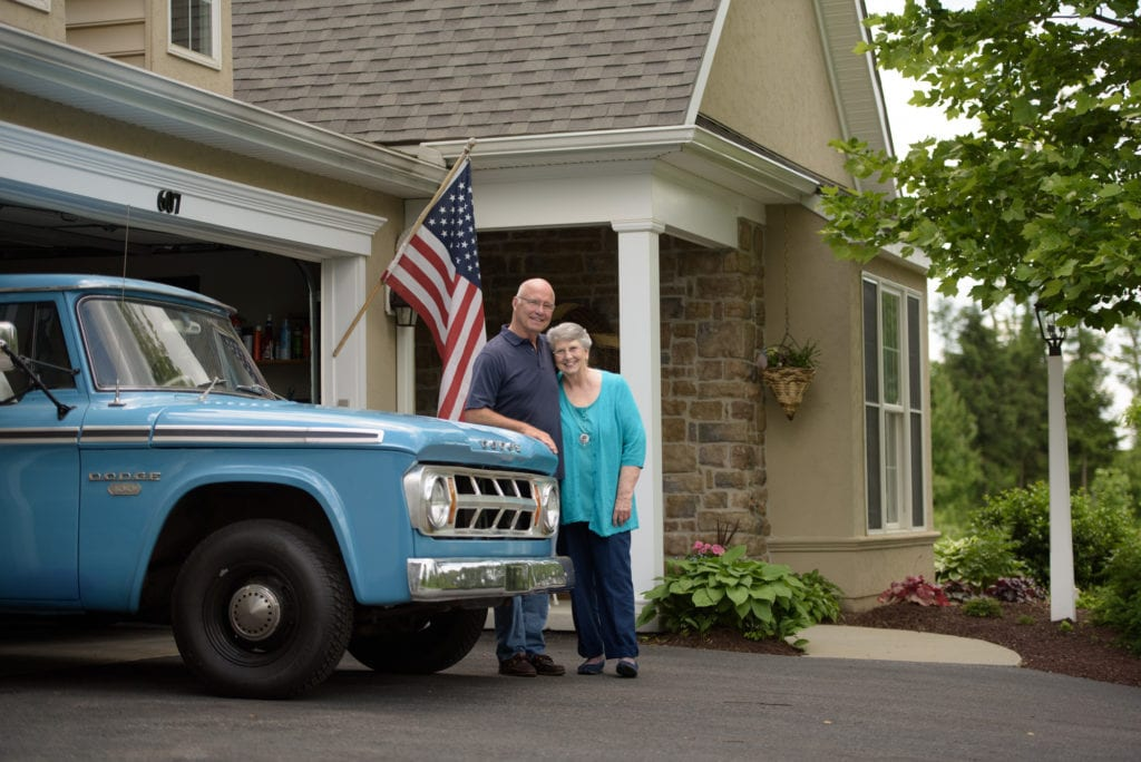 Couple with their antique truck