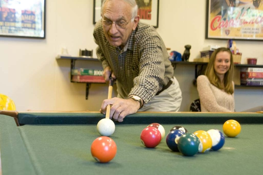 Playing pool at St. Anne's retirement community