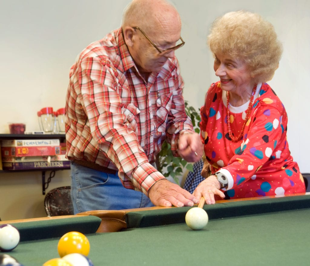 Seniors playing pool