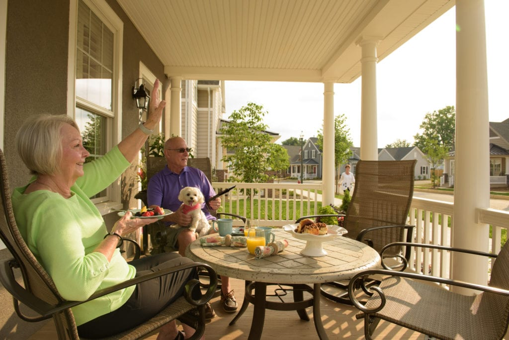 Couple on the porch Warwick Woodlands Retirement