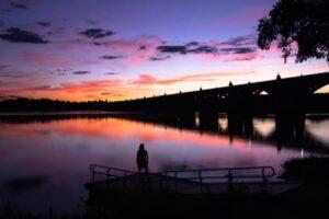 sunset behind bridge